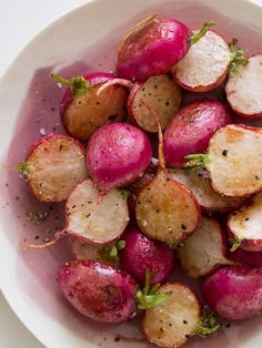 Roasted Radishes recipe - pretty tasty with that nice roasted flavor. good way to use up lots of extra radishes in one fell swoop. might be good on salads.