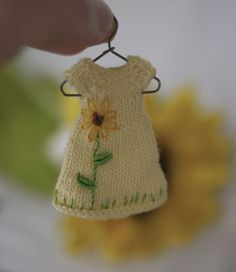 Little Sunflower, a tiny knit and embroidered dress for Amelia Thimble dolls. cindyricedesigns.com