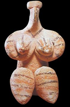 This beautiful representation of a 'Mother Goddess. The center focus is directed to the nourishment of the flowing breast. - Terracotta Goddess - Halaf 6th millennium BC