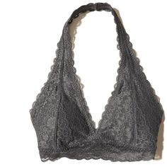 Hollister Removable-Pads Lace Halter Bralette ($17) ❤ liked on Polyvore featuring intimates, bras, grey lace, grey bra, lace halter bra, halter top, lacy bras and lace bralette bra