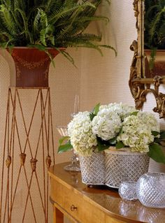 This close-up of a space designed by Margery Wedderburn Interiors features Niermann Weeks Italian Jardinière, Quatrefoil Tole Planter, and Frascati Console. niermannweeks.com #NiermannWeeks