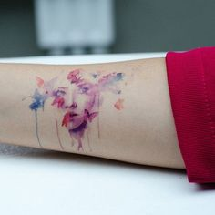 beautiful face watercolor tattoo on forearm - butterfly, water stains
