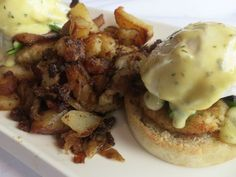 The new Sunday brunch menu at Joe Muer Seafood in Detroit includes the Joe Muer Benedict with deviled crab cakes and bacon, asparagus spears, poached eggs, Hollandaise and potatoes.