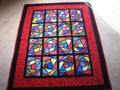 Makes me want to do another stained glass window quilt!