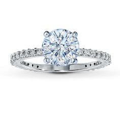 how pretty.  maybe princess or radiant cut diamond?