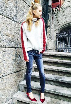 Pernille Teisbaek wears a striped sweater, skinny jeans, and velvet heels