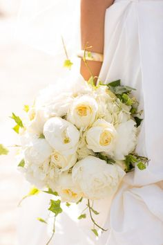 gorgeous, full bouquet in white with sprigs of green.. Ivy is actually a very symbolic wedding flower-- fidelity, friendship and affection as well as wedded love. Style Me Pretty | Gallery | Picture | #669159