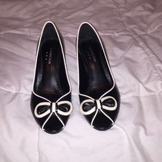 PRICE DROP! Black and white bow peep toe heels Super cute black peep toe heels with white bow and detailing around the shoe. Heel is a little over 2 1/2 inches. Worn once. In excellent condition. Covington Shoes Heels