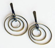 "Earrings | Art Smith.  Brass. ca. 1950's. One of the leading modernist jewelers of the mid-twentieth century, Smith trained at Cooper Union. Inspired by surrealism, biomorphicism, and primitivism, Art Smith's jewelry is dynamic in its size and form. Although sometimes massive in scale, his jewelry remains lightweight and wearable. See ""From the Village to Vogue: The Modernist Jewelry of Art Smith""."