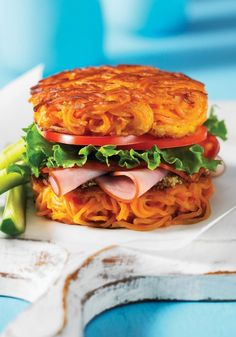 """SWEET POTATO NOODLE BUN - """"I have fantasies of eggs Benedict served atop a couple of these.dandy little gems are a surprising way to eliminate a traditional bun. They are crunchy, tasty(Sweet Potato Noodle Recipes) Sweet Potato Buns, Sweet Potato Burgers, Sweet Potato Noodles, Veggie Noodles, Zoodle Recipes, Veggie Recipes, Vegetarian Recipes, Cooking Recipes, Healthy Recipes"""