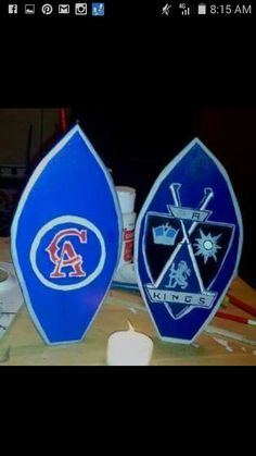 Hand cut wood mini surfboards with your favorite team Logo's on them.