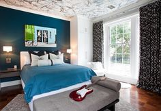 blue bedroom with large windows