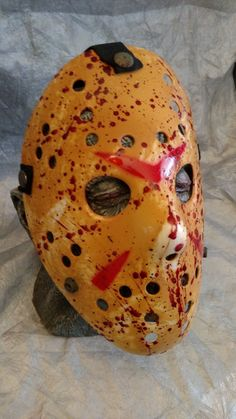 This full sized customized Friday the 13th Jason mask has amazing detail, rust finish on snaps and realistic blood splatter. This awesome collectors piece is a must have for any Friday the 13th fan or Horror Fanatic. You will absolutely love it!  NOTE: This is for the mask only and does not include the prop head behind it!  Happy Slashing!!!~