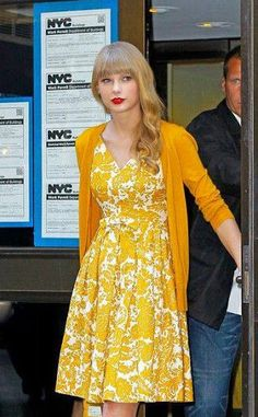 Taylor Swift in yellow floral patterns being fashion forward