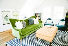 eclectic living room with moss green sofa, olive green sofa, pantone kale, white room with colorful furniture