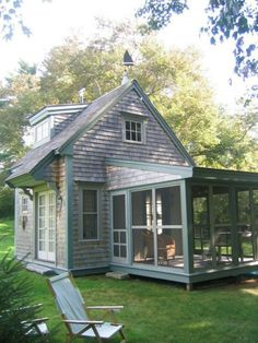 Tiny grey shingle house with screened porch