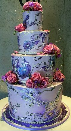 Four Tier Lavender Brocaide Wedding Cake by Rosebud Cakes.  truly a piece of art.