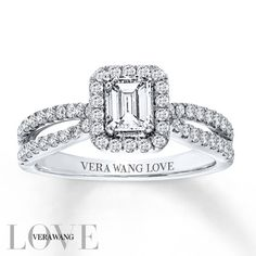 From the Vera Wang LOVE Collection, this exquisite engagement ring features a 1/2 carat emerald-cut center diamond surrounded by round diamond accents. Two princess-cut sapphires, the signature of the collection and a symbol of faithfulness and everlasting love, are set into the ring's bezel. The split band is also lined with sparkling accent diamonds, completing this exquisite look. The 14K white gold ring, with 1 carat total weight of diamonds, is a brilliant beginning to your romantic…