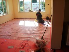 An Allbrite electric ribbon underfloor heating installation in a living room with carpet flooring. Underfloor Heating Installation, Electric Underfloor Heating, Underfloor Heating Systems, Types Of Flooring, Living Room Carpet, Carpet Flooring, Ribbon, Home Appliances, Tape