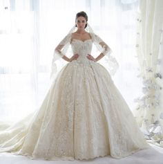 All over lace sweetheart neckline ball gown wedding dress