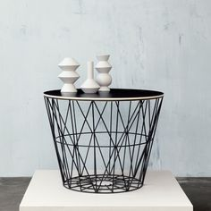 This Black Wire Basket can store everything from magazines to toys and turns into a side table with its wooden top