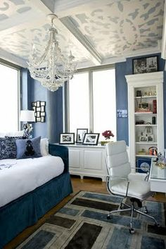 ceiling painted with white and blue stencil add interest to this room