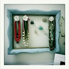 DIY picture frame jewelry hanger (I bet Ross would have frames like this)
