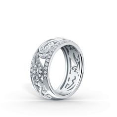 This whimsically chic, artistic design is a ladies' band from the Angelique collection. It features 3/8 ctw of diamonds and signature handcrafted milgrain edging.