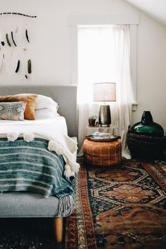 boho bedroom with ottoman as nightstand