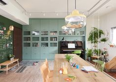 Taiwanese studio HAO Design installed a play area in the kitchen of this family home so the children could spend more time with their parents