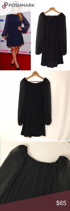 TOPSHOP sheer puff sleeve shift dress black 2 New, unworn condition, partial tags attached. Short shift dress with sheer voluminous long sleeves with zip detail at back. 100% Viscose. box pleats at front neck line. Unlined. May require appropriate undergarments. Rear zip. Bust 37 waist/hip open  Length32.5 Topshop Dresses Long Sleeve