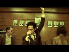 Nick Cave & The Bad Seeds - Fifteen Feet Of Pure White Snow.  See how many people you can spot in this video, they all look like they are having a great time. Look out for Jason!