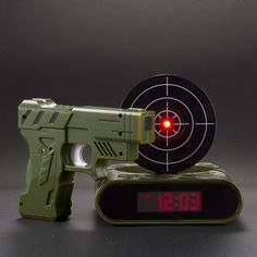 An alarm clock you have to shoot to get it to turn off...awesome!