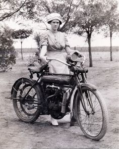 """Who is she? Seems to be holding the bike, not just standing next to it. Flying Merkel motorcycles were made from 1908 to 1912. In 1910, the motorcycles carried the famous name of """"The Flying Merkel""""  The brand's association with racing was so prominent that race versions of the 1910 Flying Merkels could be ordered directly from the catalog."""