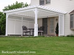 14'x14' Traditional Vinyl Pergola with Privacy Wall and Superior Posts http://www.backyardunlimited.com/pergolas