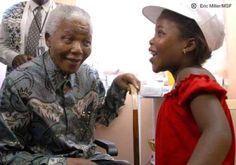 Nelson Mandela talking to an HIV-positive child