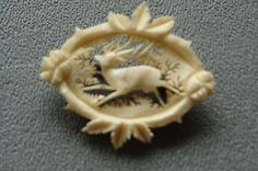 VINTAGE-CARVED-CELLULOID-PIN-BROOCH-WITH-DEER