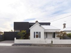 The modern addition behind the white-picketed original building. Hope Street House (Geelong West, Australia) by Steven Domoney Brick Cladding, House Cladding, Facade House, Exterior Cladding, Facade Design, House Design, Ranch House Additions, Street House, St Street