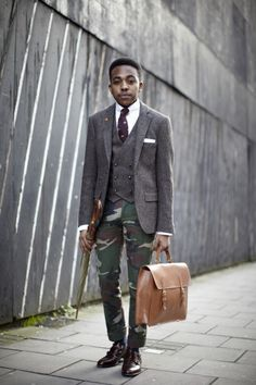 Trend overload from Nigel but he pulls it off brilliantly - working camo plus a tweed waistcoat and blazer set. Loving the tan satchel too #BurtonStreetStyle