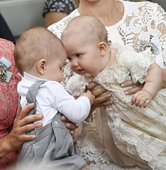 (L-R) Swedish Prince Oscar and Prince Alexander having a serious baby talk at Palace Chapel in Drottningholm Palace in Stockholm during the christening service of the five month-old Prince Alexander on September 9, 2016