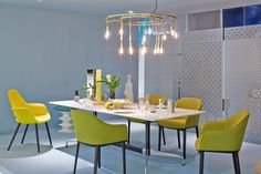 Lovely dining room setting with an Eames Segmented Base Table and an Eames Saarinen Organic Chair by @vitra