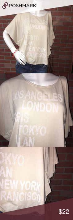 Nwt vintage Paris NY London top Brand new. L. O. L. Vintage   Color is ivory. Sz med. 65% polyester 35% rayon. Tops