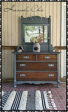 """This gorgeous antique Tiger Oak chest with amazing beveled mirror. I couldnt cover up all her amazing wood grain, it made her who she is. So I stained her down and restained her. She got drenched in a custom gray with highlights throughout. To top her all off, she got all her sides of her drawers some beautiful flower decoupage!"" - Heavenly Chic Refinishing Heavenly Chic used Brown Mahogany Gel for the stain. To achieve the gray color, you could use GF Driftwood Milk Paint"