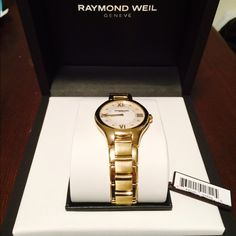 ⚡️SALE!! ⚡️Raymond Weil Noemia Yellow Gold Ladies DONT MISS THIS SALE!  BRAND NEW, still has tags on it! Received this watch as a gift but it's not my style. Both the stainless steel bracelet and case are plated in yellow gold. The mother-of-pearl dial is adorned with 8 diamonds. Diamonds total 0.06 carats. Comes with original box, instructions for use, international guarantee booklets, as well as proof of purchase on 12/17/14 from Longs Jewelers. OPEN TO OFFERS!! Raymond Weil Accessories…