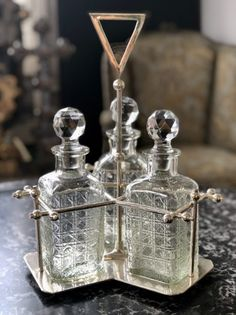 A silver plate Art Deco style three bottle decanter set