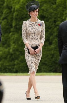 Kate Middleton wearing a cream and black lace dress