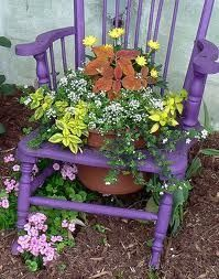 Upcycle an old chair with a bright purple-blue paint job and make a hole in the seat for a planter. Grow foliage and flowers in complimentary colors for some garden WOW!