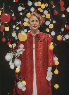 An illuminating evening look from the pages of Vogue's February 1957 edition. #vintage #fashion #coat #1950s