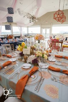 Gorgeous Floral Pattern on Linen with bright napkins is the ultimate Spring look all done by Bells & Whistles in the Outer Banks