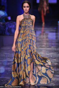 A model walks the ramp to showcase a creation by designer JJ Valaya during grand finale of the Wills Lifestyle India Fashion Week (WIFW) 2012 in Delhi.